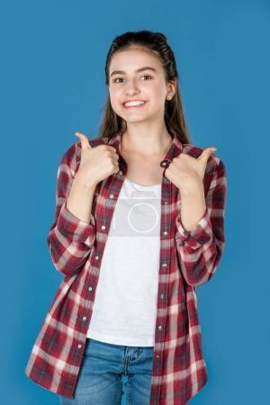 teen girl showing thumb up