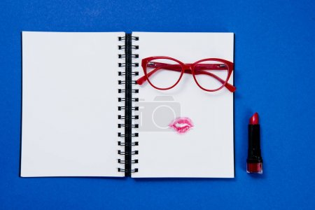 Pair of glasses on notebook