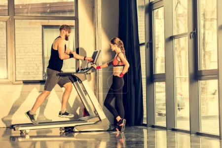 Sportspeople training with treadmill