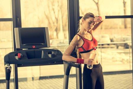 Sporty woman on treadmill