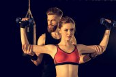 Sporty man and woman training