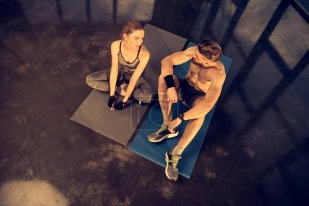sportsman and sportswoman resting