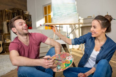 Young couple painting together