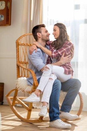 Happy couple in rocking chair