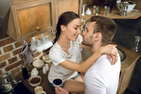 Couple in kitchen in morning