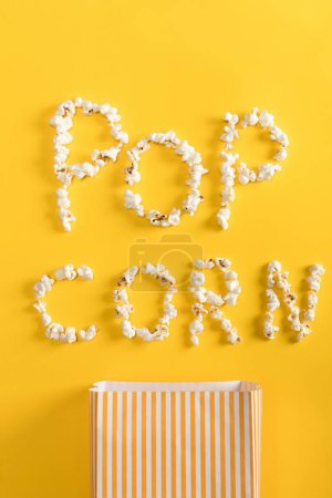 Photo for Top view of Pop corn lettering  made from popcorn on yellow - Royalty Free Image