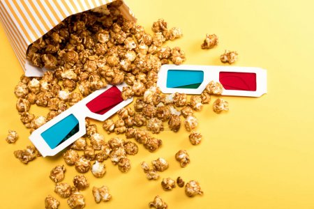 Photo for Close up view of popcorn and 3D glasses on yellow, Movie time concept - Royalty Free Image