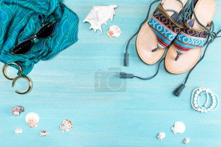 Photo for Top view of sunglasses, sandals, scarf and sea shells on table - Royalty Free Image