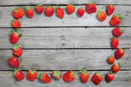 Frame of fresh strawberries