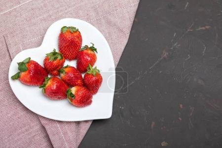 strawberries on heart shaped plate