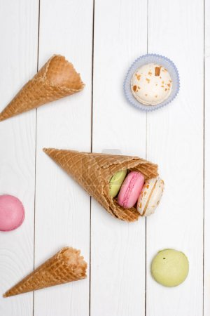waffle cones with colorful macarons