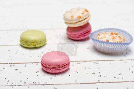 Group of macarons on wooden table
