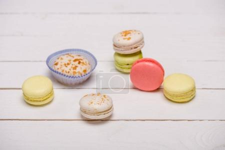 Photo for Variety of fresh macarons on wooden table.  sweets background - Royalty Free Image