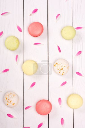 Photo for Top view of various of fresh handmade macarons with pink petals.  macarons pattern concept - Royalty Free Image
