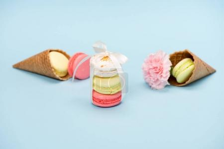 Macarons tying with white ribbon for gift