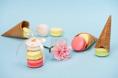 Macarons with flower and waffle cones