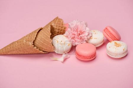 Fresh macarons in waffle cones