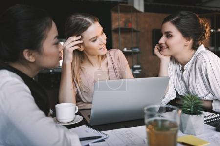 multiethnic businesswomen in cafe