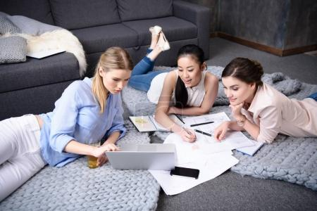Photo for Young businesswomen working on laptop together at home - Royalty Free Image