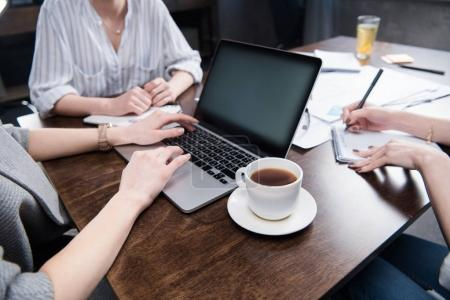 businesswomen working with laptop and coffee cup