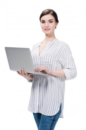 caucasian woman using laptop while standing