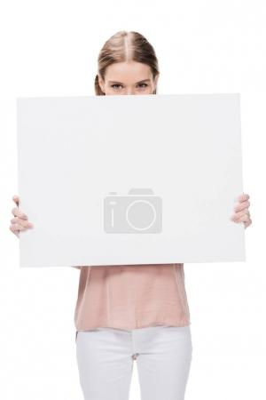 young woman holding blank banner