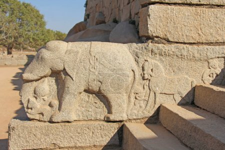Elephant. Stone bas-reliefs on the walls in Temples Hampi. Carving stone ancient background. Carved figures made of stone. Unesco World Heritage Site. Karnataka, India. Royal enclosure.