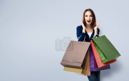 Beautiful woman in casual clothing with shopping bags
