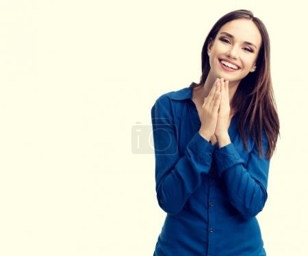 Photo for Portrait of happy gesturing smiling young woman in casual smart blue clothing, with copyspace for slogan or text message - Royalty Free Image