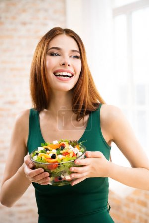 Photo for Portrait of happy smiling young woman with vegetarian vegetable salad, indoors or at home. Beauty and dieting concept. Weight lossing, by healthy eating. - Royalty Free Image