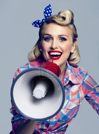 smiling woman with megaphone, dressed in pin-up style