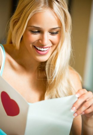 happy smiling woman, reading valentine card
