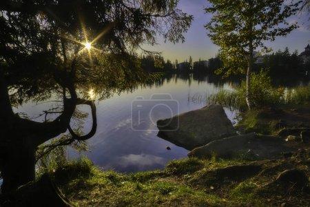 On the shore of morning lake Strbske pleso