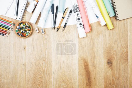 Wooden desk top with supplies
