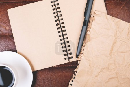 Modern workplace with empty notepad