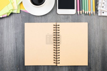 Office desk top with empty notepad