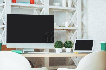 Desktop with empty computer screen