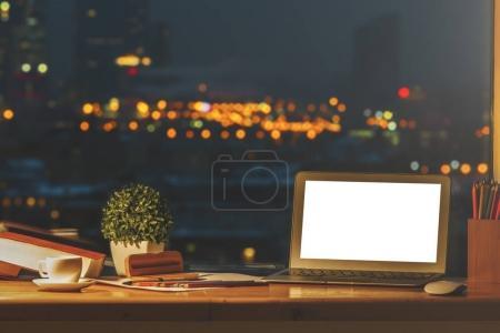 Designer desktop with empty notebook