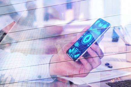 Photo for Side view of hand holding smartphone with ethereum app at workplace with city view. Cryptocurrency and trade concept. Double exposure - Royalty Free Image