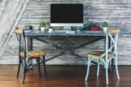Stylish interior with empty computer