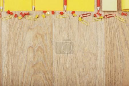 Wooden table with colorful supplies