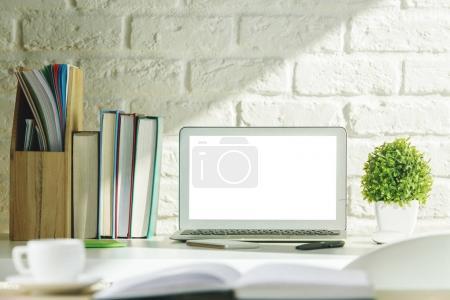 Creative modern desk with white laptop