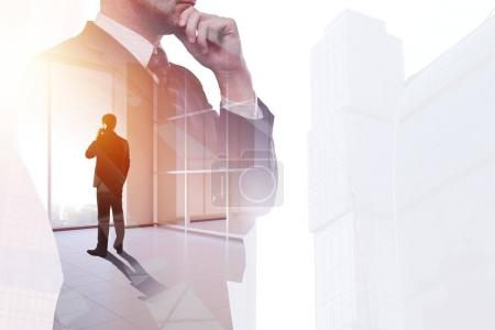 Photo for Businessman on abstract office city workplace background. Success and communication concept. Double exposure - Royalty Free Image