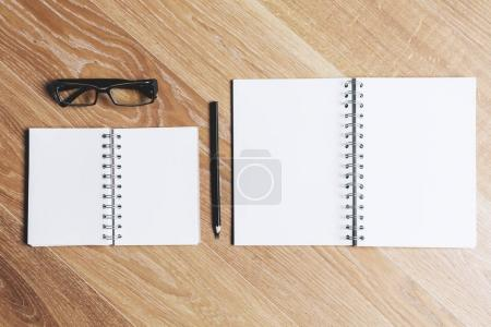 Empty notepads and glasses