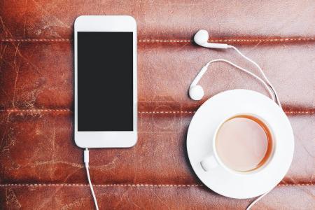 Smartphone, headphones and coffee
