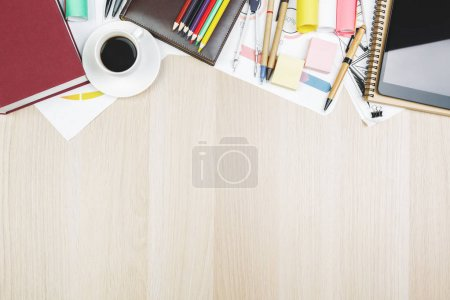 Wooden table with devices and supplies