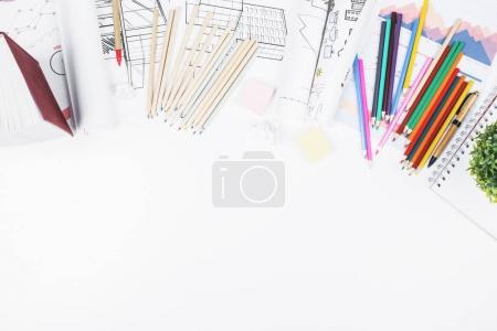 White office desktop with various items