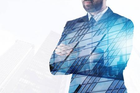 Photo for Success and lifestyle concept. Businessman on abstract office city background with copy space. Double exposure - Royalty Free Image