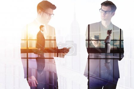 Photo for Businessmen in modern office interior with city view. Meeting and conference concept. Double exposure - Royalty Free Image