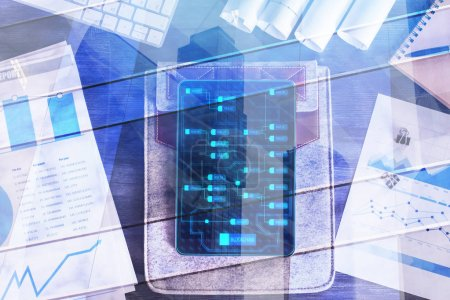 Photo for Top view of tabet with digital chart on screen placed on office desk with report and other items. Technology and finance concept. Double exposure - Royalty Free Image